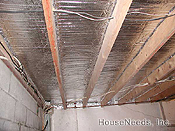 Foil Poly Foam Foil Insulation with staple tabs 2 rolls, 1/4 inch thick X 125 feet long X 24 inches wide - 24EFEC/LS240 installed under a wood joist floor - PEX tubing is above foil insulation and below wood floor