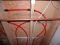 24 inch PEX Slide Brackets for Under Floor Installations - ET-125G installed under a floor before insulation installed
