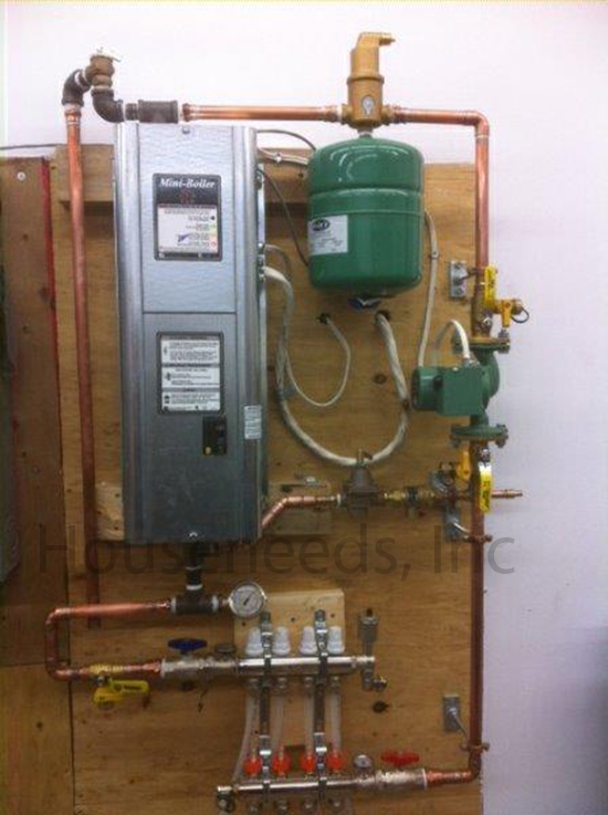 This is an example of a Residential Electric Boiler Install with a PEX Manifold and 4 Loops Finished