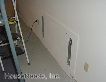 Attaching the mounting brackets to the Hydronic Radiators System